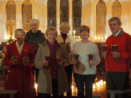 Holy Trinity Handbell ringers at Carols by Candlelight