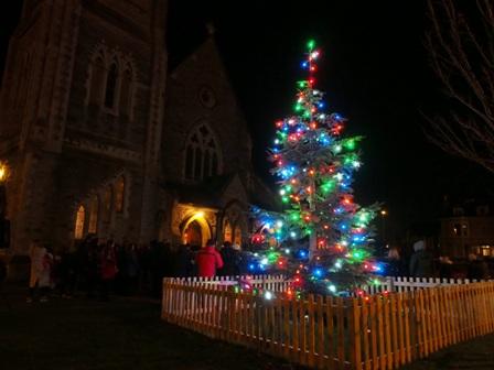 Carols around the Christmas tree