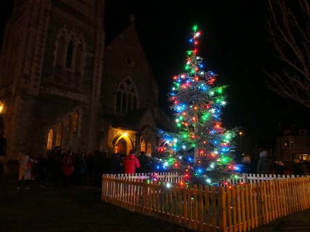Carols around the Christmas tree
