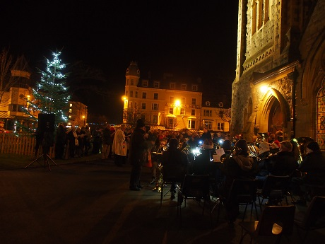Carols around the Christmas tree.
