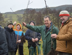 Steve and Dewi with students from GCSE Land Based Studies, planting trees in Llanyllin.