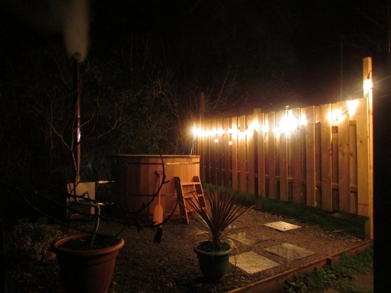 wood fired soaking tub at night