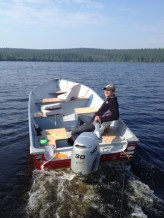 Derrick is driving on a nice calm lake. No big deal. Notice the ropes tied to the back of the boat...