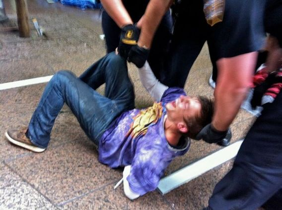 Occupy Wall Street man on ground being arrested 01