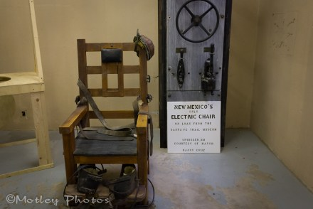 Electric chair. On loan from the Santa Fe museum. Was the actual chair used in the prison.