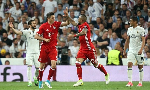 Robert Lewandowski celebrates with Arturo Vidal after levelling the scores on aggregate. Image from: Getty