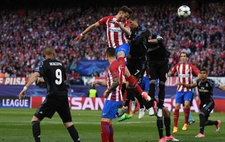 Saúl Ñíguez heads home to put Atlético Madrid ahead on the night. Image from: BPI
