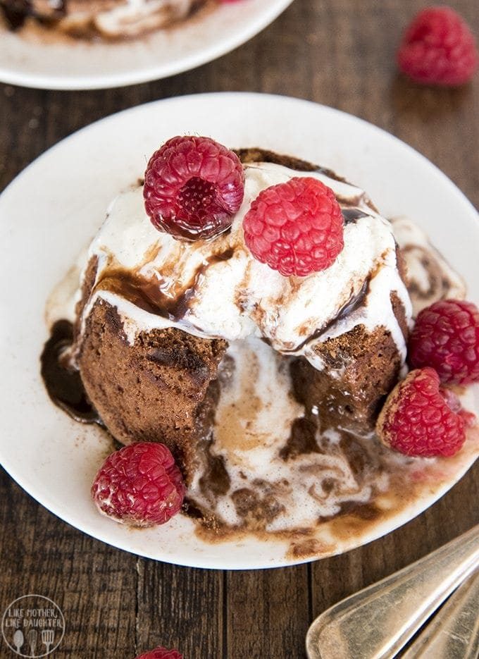 These chocolate molten lava cakes are the perfect chocolatey dessert! A soft and rich chocolate cake with a gooey center served hot, and best with ice cream and fresh raspberries on top for a dessert that tastes like restaurant quality, made at home!