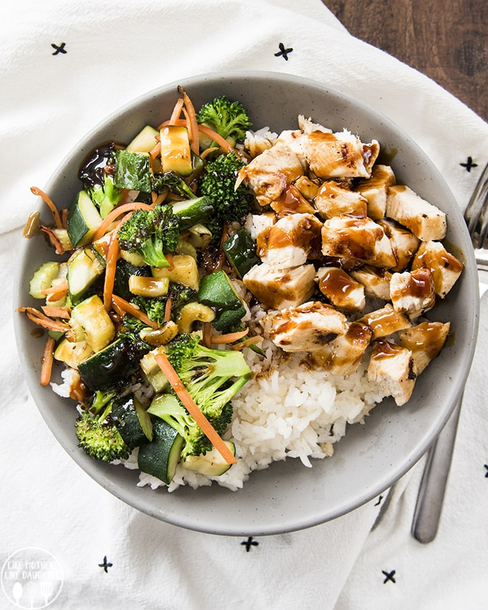 Hawaiian Teriyaki Chicken Bowl with coconut rice, veggies, chicken and a homemade hawaiian teriyaki sauce.