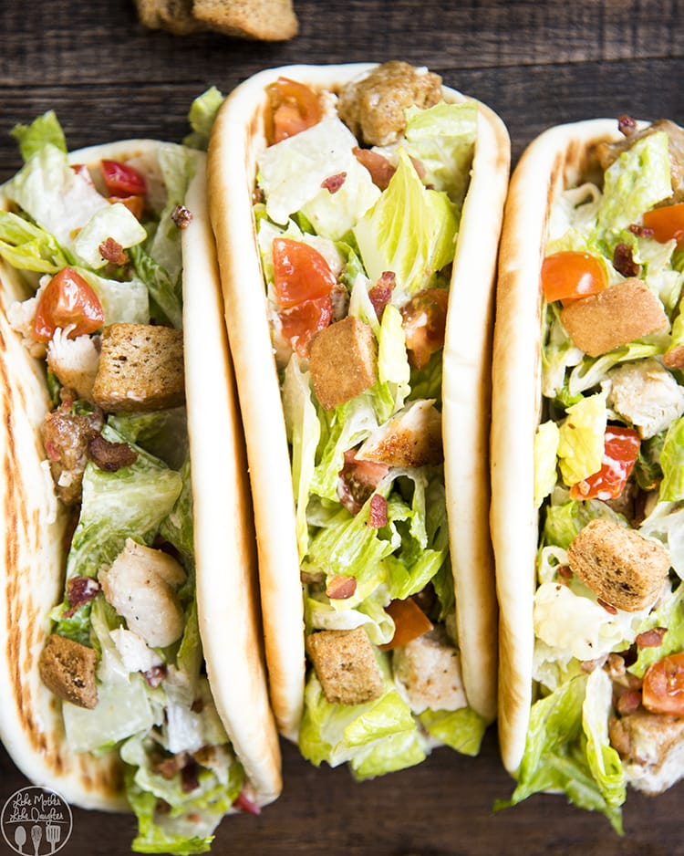 Chicken Caesar Salad Pitas are a delicious and easy caesar salad served up in a pita with grilled chicken, romaine lettuce, parmesan cheese, and caesar dressing. These pitas are the perfect easy lunch or dinner!