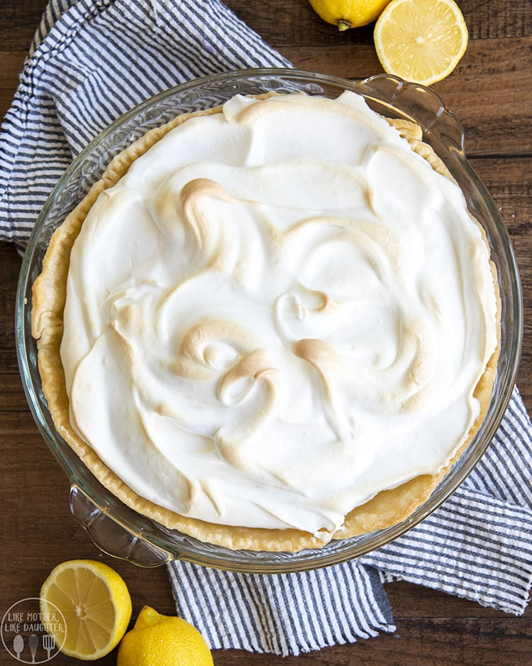 A lemon meringue pie topped with a thick layer of meringue