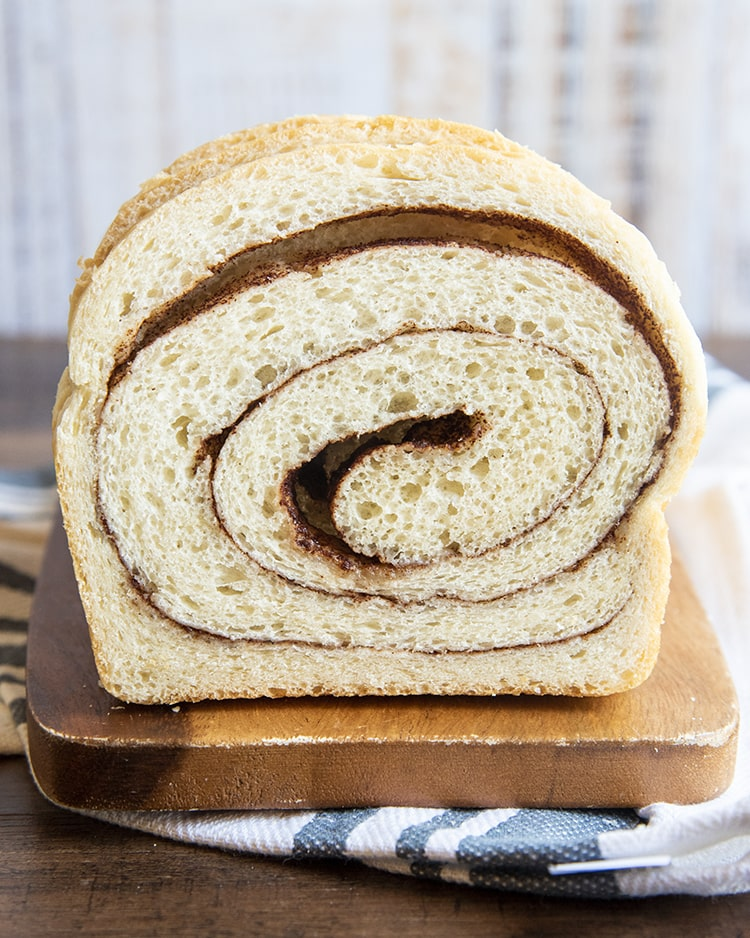 A loaf of bread with cinnamon swirled throughout