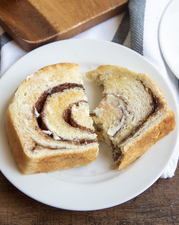 A slice of cinnamon bread on a white plate