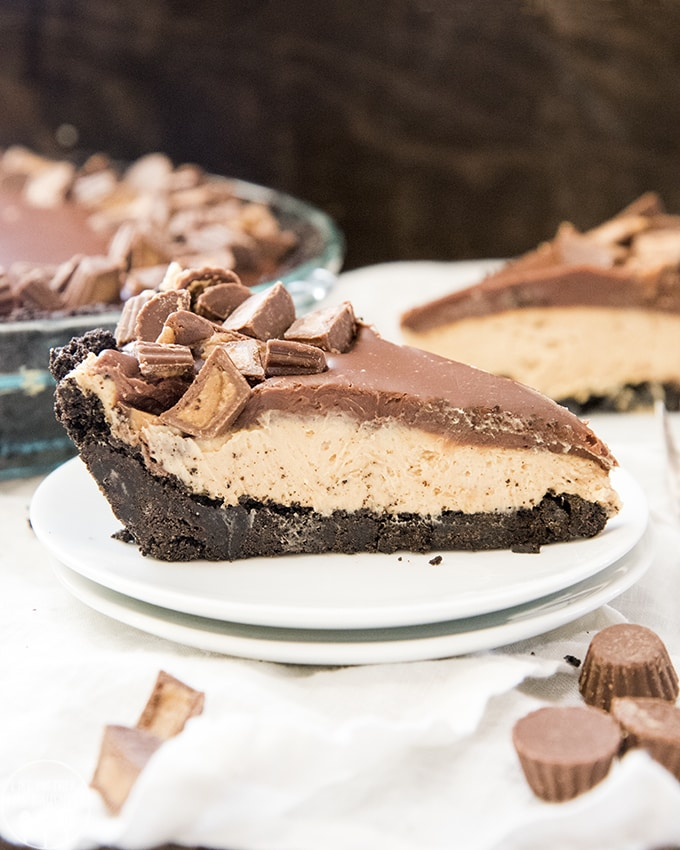 Reese's Peanut Butter Pie is a delicious no bake dessert, with an oreo crust, and creamy peanut butter filling, all topped with a rich chocolate ganache and peanut butter cups!