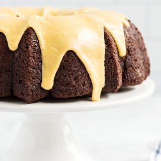 Chocolate pumpkin bundt cake on a cake stand