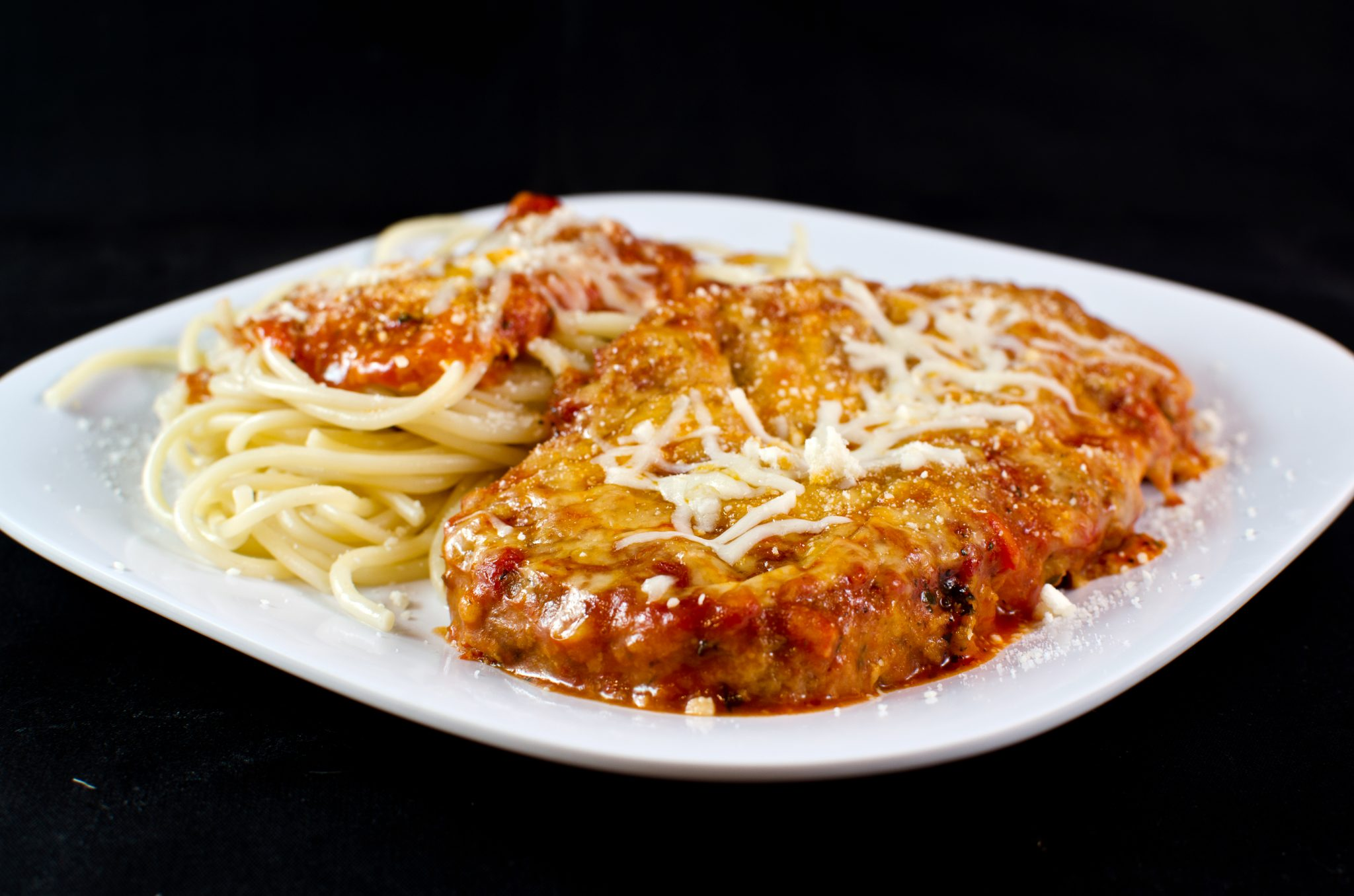 Eggplant Parmesan - This eggplant parmesan is a delicious simple breaded eggplant, covered in sauce and cheese served with pasta for a delicious vegetarian meal option!