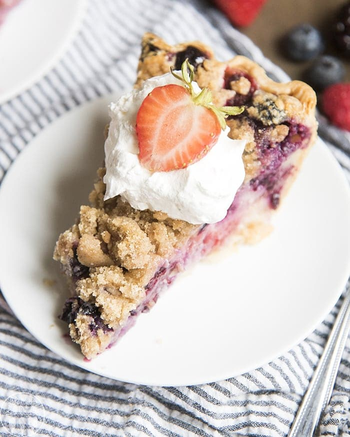 A gorgeous berry custard pie with mixed berries, a sour cream custard and a crumb streusel topping, the perfect pie for the holidays!