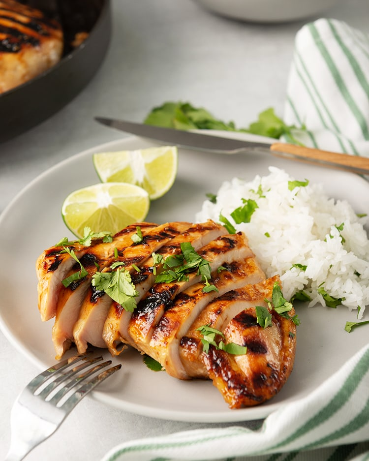Honey Lime Chicken breast on a plate with cilantro rice