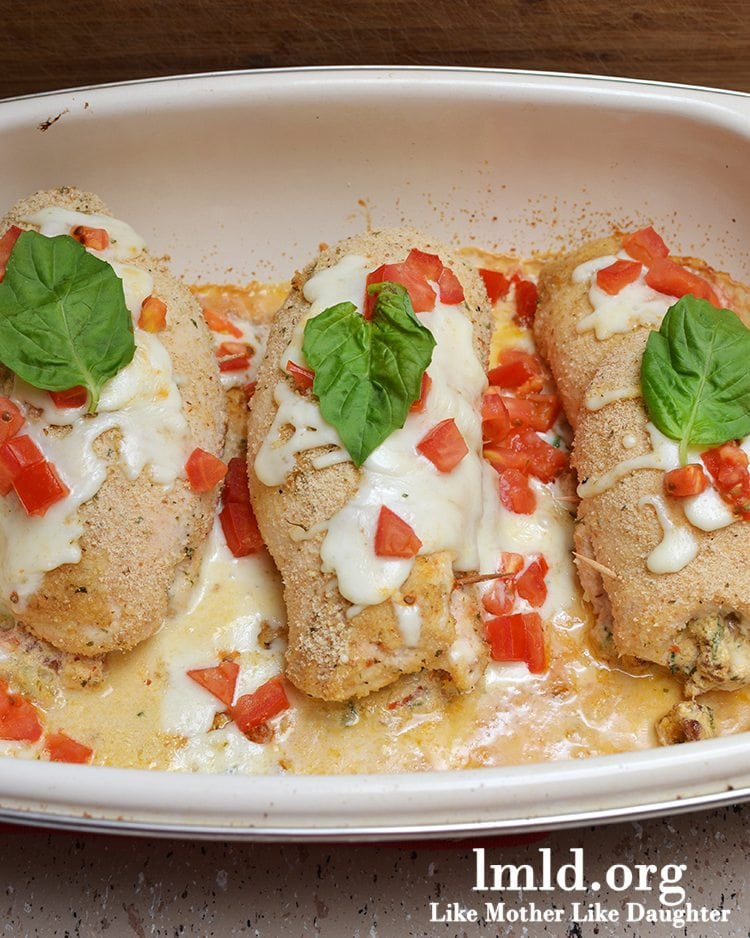 Italian Stuffed Chicken Breast - This chicken breast is stuffed full of so many tasty ingredients, tomato, mozzarella, fresh basil and more all coated in bread crumbs and baked for a moist and flavorful chicken everyone will love!
