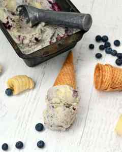 Smooth and creamy homemade ice cream with real bananas and blueberries for a delicious banana blueberry swirled ice cream dessert.