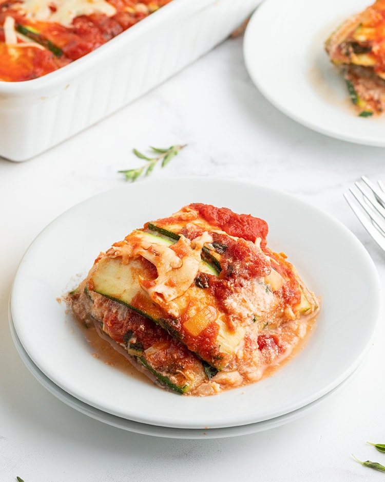 A plate of zucchini lasagna, showing the layered zucchini, red sauce and cheese.