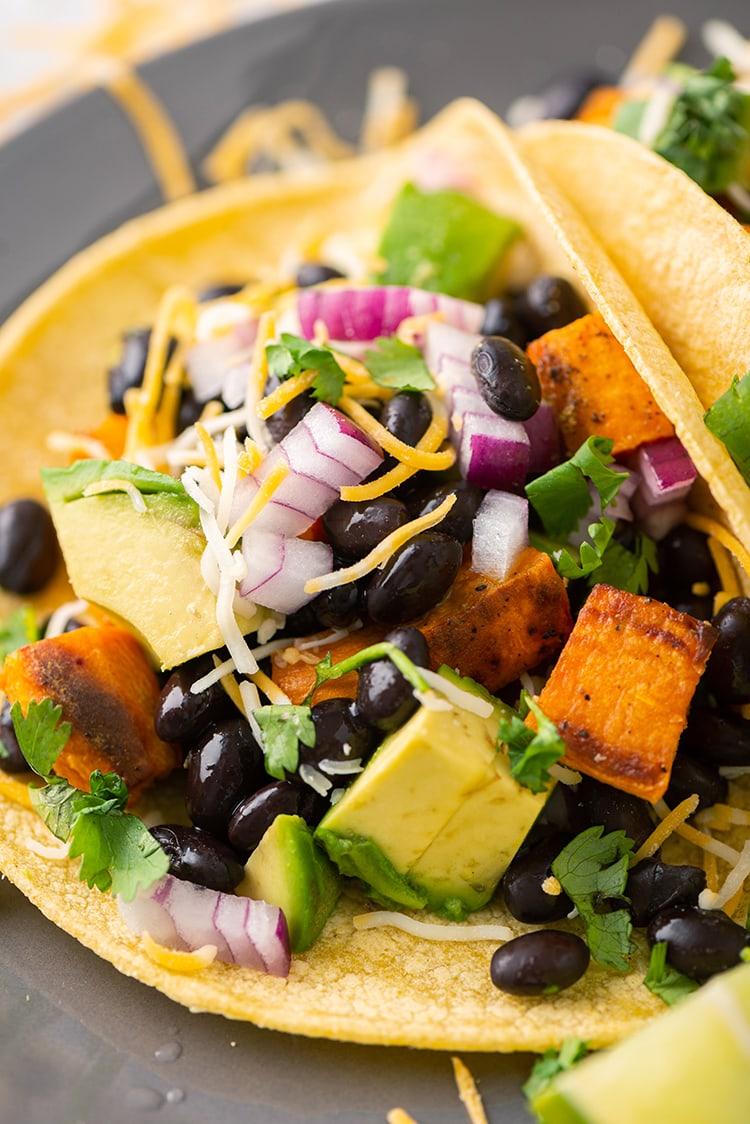 A close up shot of a sweet potato and black bean taco