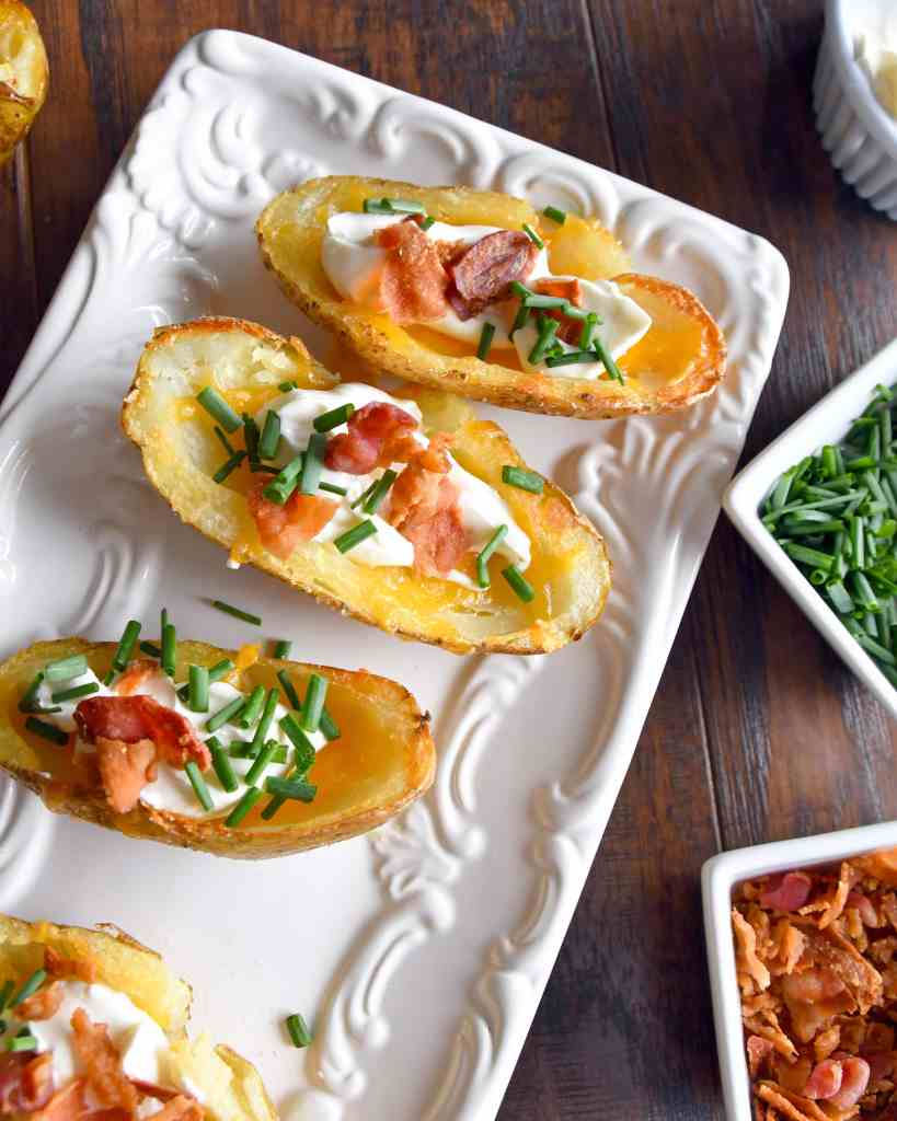 These crispy, cheese filled potato skins are a first-rate appetizer; top with bacon bits, sour cream, and chives. Enjoy them on your First Night Eve or any other time an appetizer is on the menu.