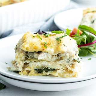 Chicken lasagna with spinach on a plate.