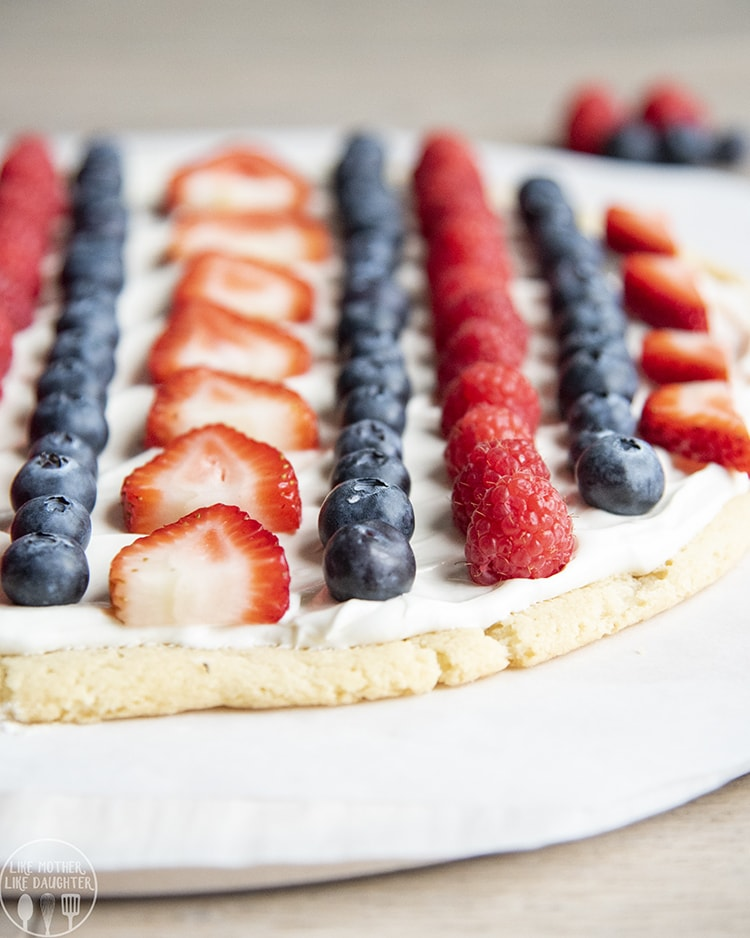 Patriotic Fruit pizza topped with blueberries, strawberries, and raspberries