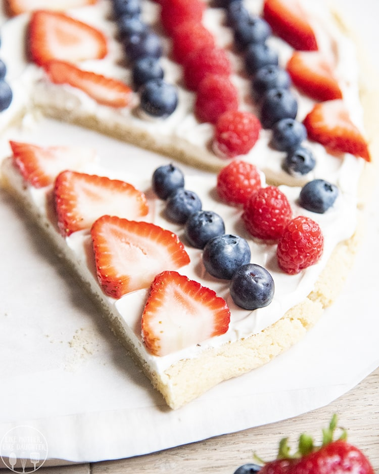 Fruit pizza topped with blueberries, strawberries, and raspberries