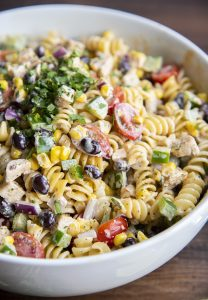 Close up of southwest pasta with pasta, chicken, vegetables and a chipotle ranch dressing