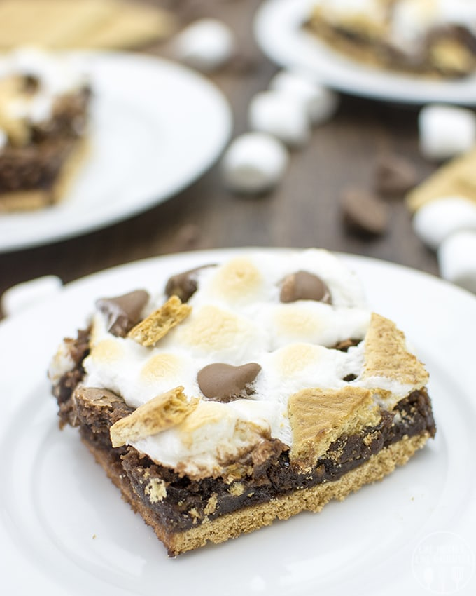 S'mores brownies start with a graham cracker bottom, brownie in the middle, and are topped with gooey marshmallows. You get the delicious flavor of s'mores but in brownie form!