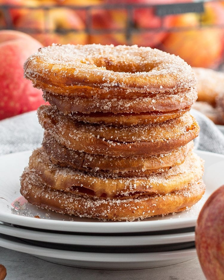 A stack of fried apple rings on a plate.