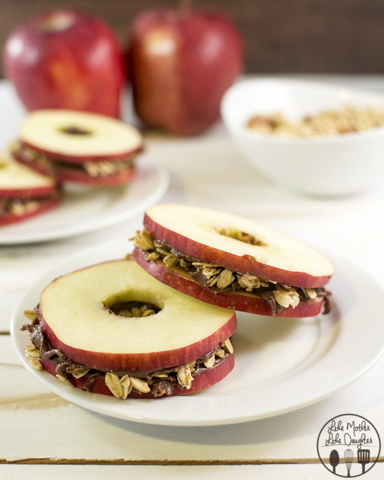 Apple Snack Sandwiches - These delicious apple sandwiches are spread with Reeses Spreads then topped with granola for a perfect snack that everyone will love!
