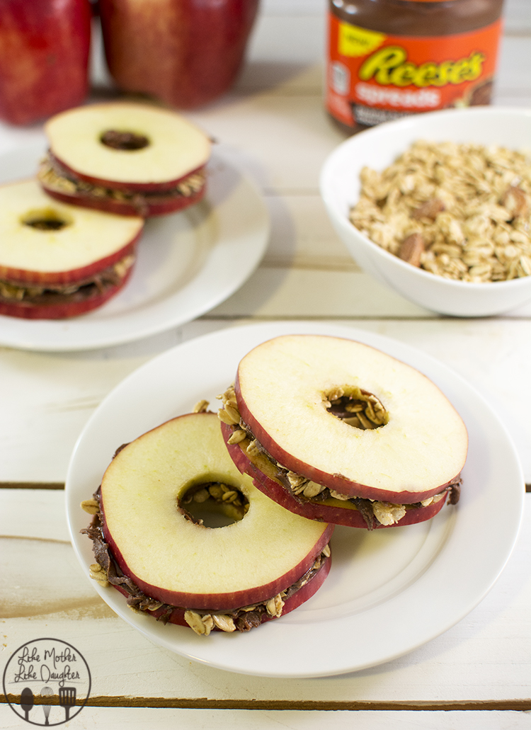 Apple Snack Sandwiches - These delicious apple sandwiches are spread with Reeses Spreads then topped with granola for a perfect snack that all will love!