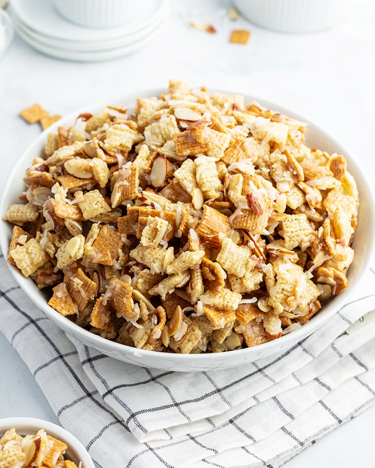 A bowl of gooey coconut holiday chex mix.
