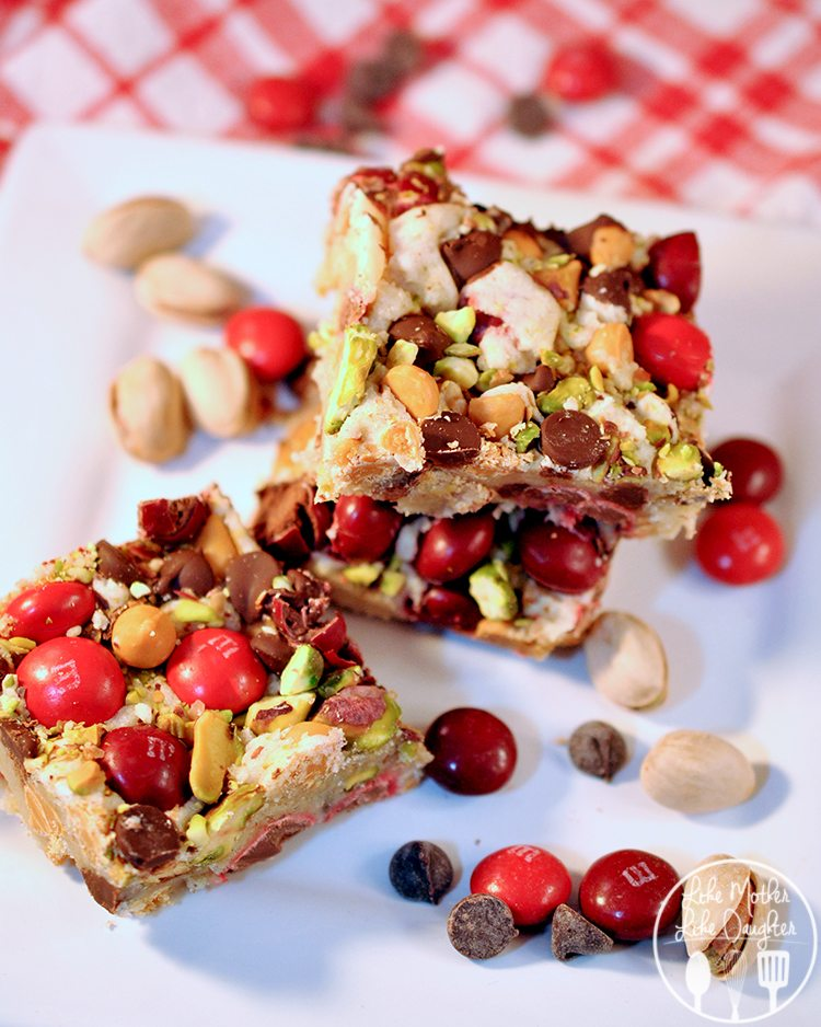 Loaded Sugar Cookie Bars - These bars are brimming with M&Ms, chocolate and butterscotch chips, and pistachio nuts. With each bite-full your mouth is thanking you.