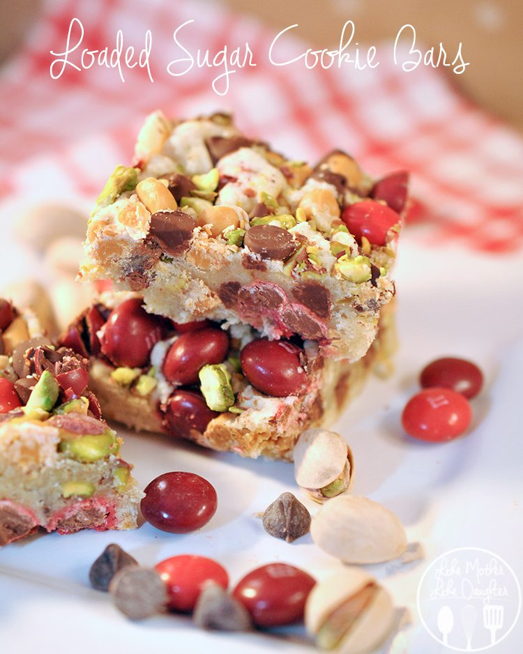 Loaded Sugar Cookie Bars - These bars are brimming with M&Ms, chocolate and butterscotch chips, and pistachio nuts. With each bitefull your mouth is thanking you.