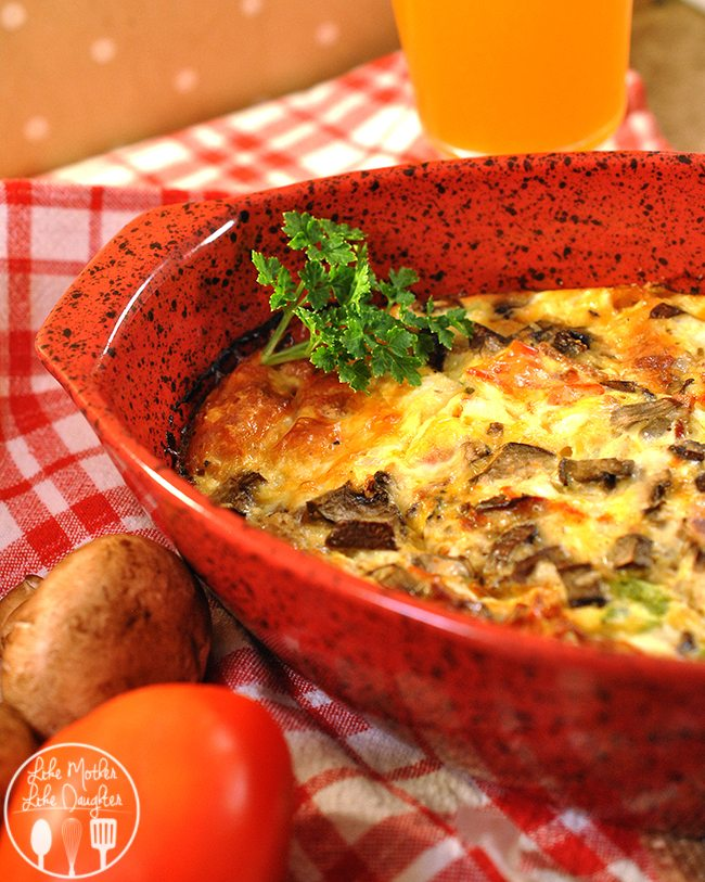 Baked Omelet - A delicious easy to make omelet, cooked in the oven, and stuffed full of cheese and fresh vegetables for a delicious breakfast, or breakfast for dinner meal!