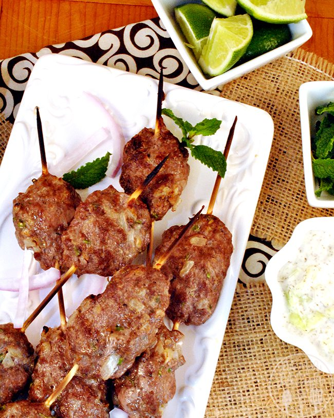 Lamb Kebabs - these kebabs add a Middle Eastern flair to your dinner experiences. A robust flavor of lamb eaten in a pita, served with mint, red onions, and yogurt-cucumber dressing for easy hands on eating.