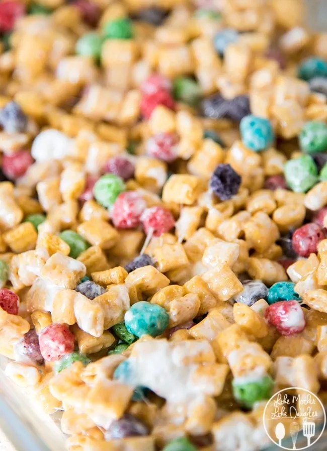 Captain crunch rice krispies are gooey cereal bars made with captain crunch cereal and marshmallows! They're the perfect snack for Cap'n Crunch lovers!