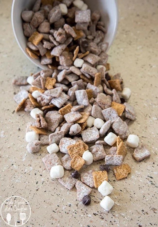 S'mores muddy buddies are such a great treat, with all time favorite chocolate and peanut butter muddy buddy flavors with marshmallows and golden grahams mixed in. They're the perfect snack for after school, watching a movie, or whenever.