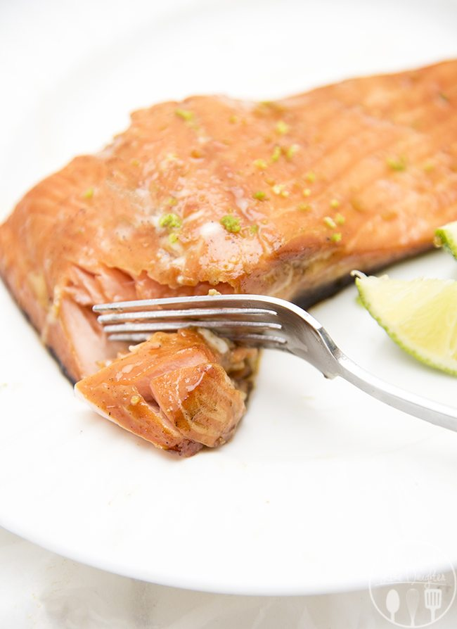 Honey Lime Salmon - An easy and flavorful salmon that you will love! Its marinated in a delicious honey lime sauce and cooked in less than 30 minutes, for a perfectly flaky, tender and flavorful salmon!