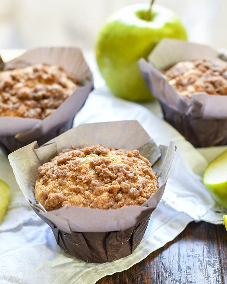 These apple crumb muffins are baked with apples and applesauce inside the muffins, then topped with an amazing cinnamon crumb streusel topping!