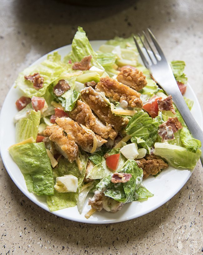 Crispy Chicken Cobb Salad is packed full of crispy chicken, boiled eggs, bacon, tomatoes, and cheese! All topped with your favorite dressing for a great main dish or side!