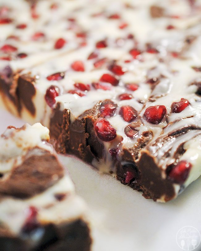 Swirled Pomegranate Fudge - A white chocolate and milk chocolate swirled pomegranate fudge that is so richly delicious with crunchy pomegranate arils that only takes 3 minutes in the microwave.