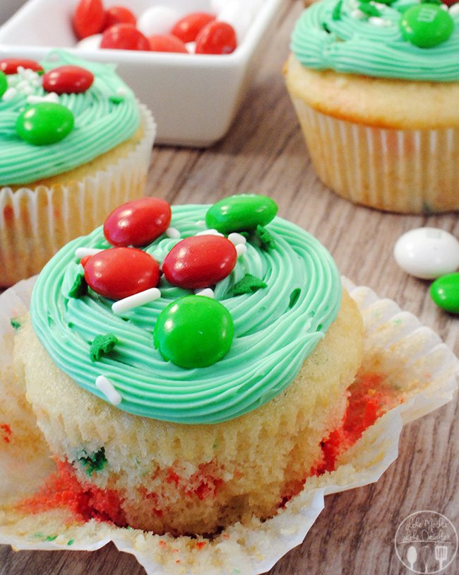 Festive Funfetti® cupake - these cupcakes have M&M's® White Peppermint baked right in and decorated with M&M's® Holiday Milk Chocolate for real festive fun