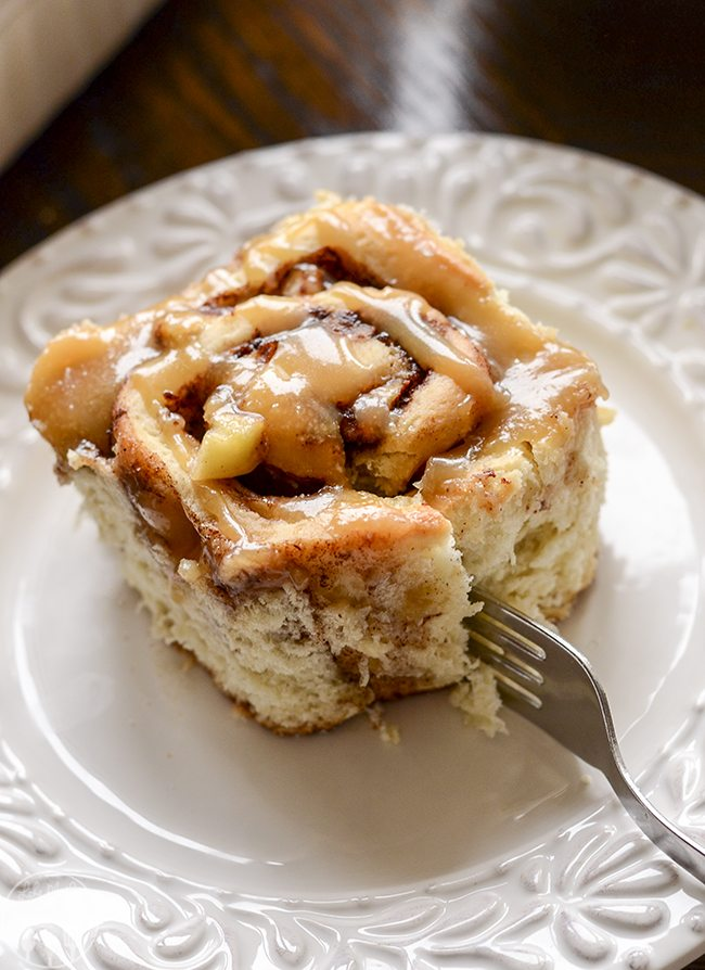 Caramel Apple Cinnamon Rolls - These delicious sweet rolls are stuffed full of brown sugar, cinnamon and apples and covered in a warm caramel syrup! Perfect for breakfast or brunch!