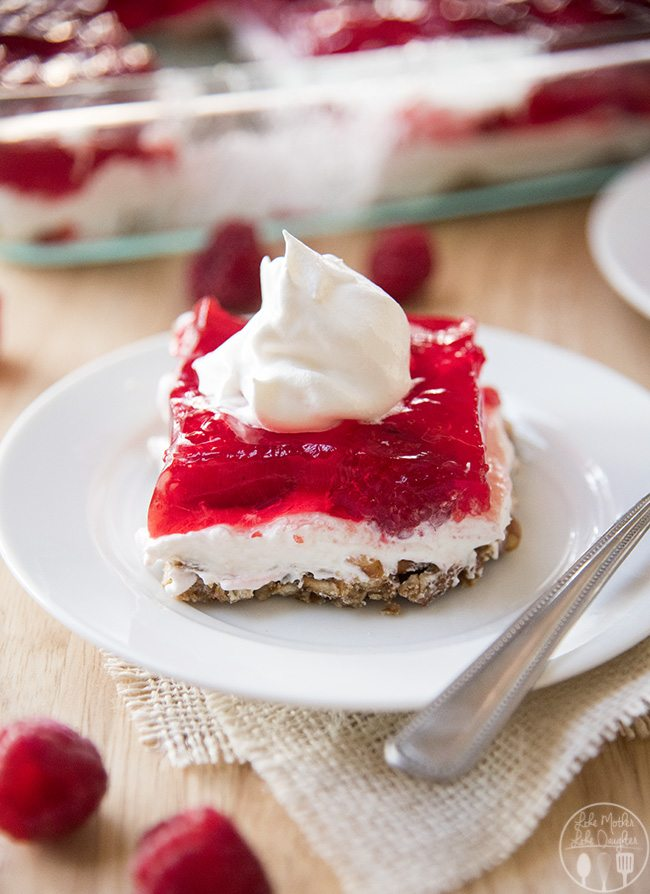 Jello salad is made even better with a cream cheese cheesecake layer, and crunchy salty pretzel layer!