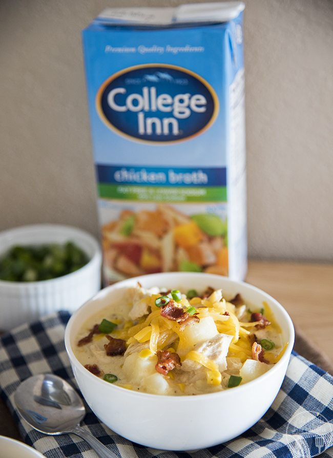 Cheesy Chicken Chowder - A creamy and cheesy chicken chowder packed full of potatoes, corn, shredded chicken and cheese. Top each bowl with cheese, bacon, and green onion for a burst of flavor with each bite, perfect for a cold day!